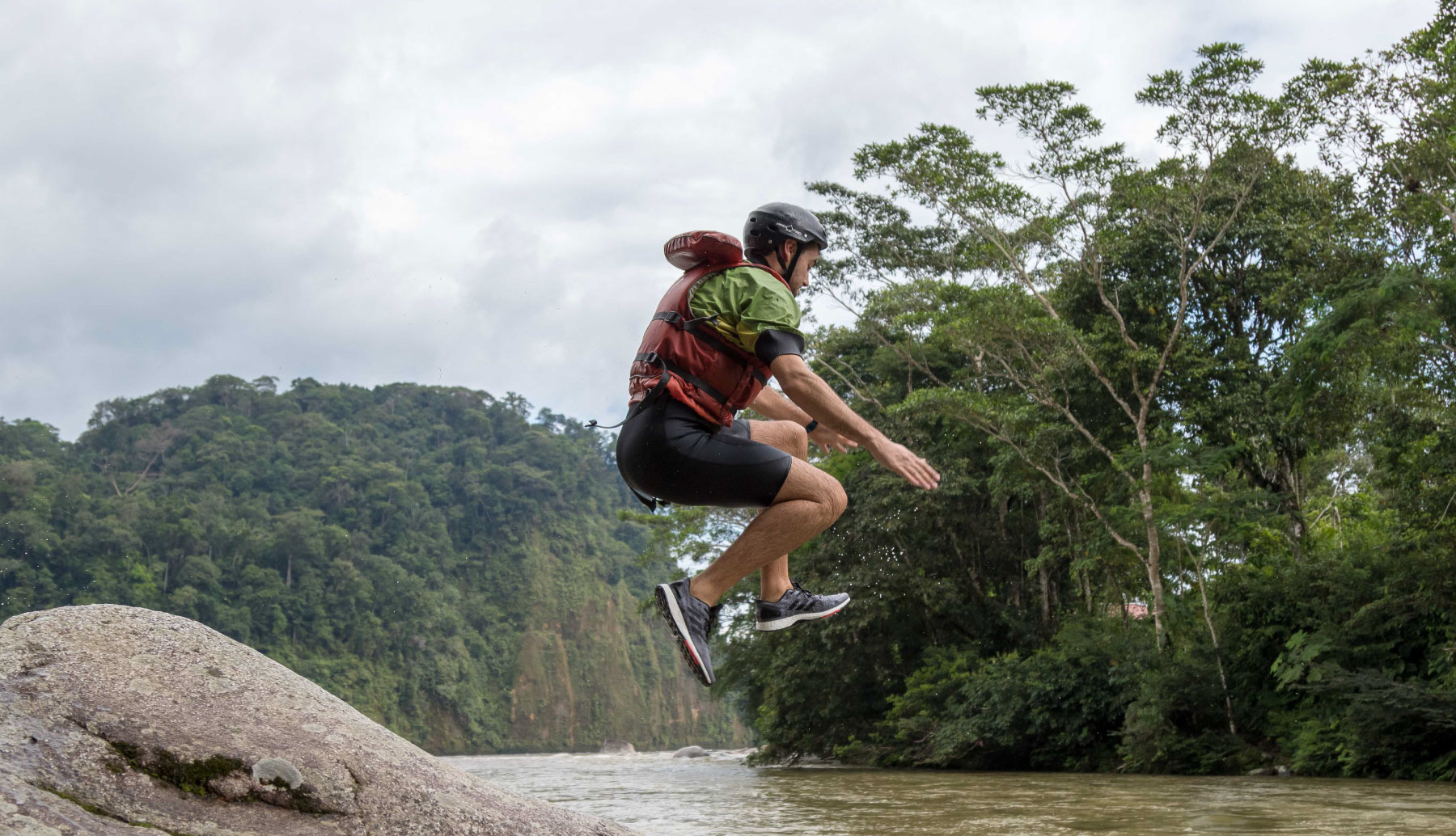 Man jumping to the river