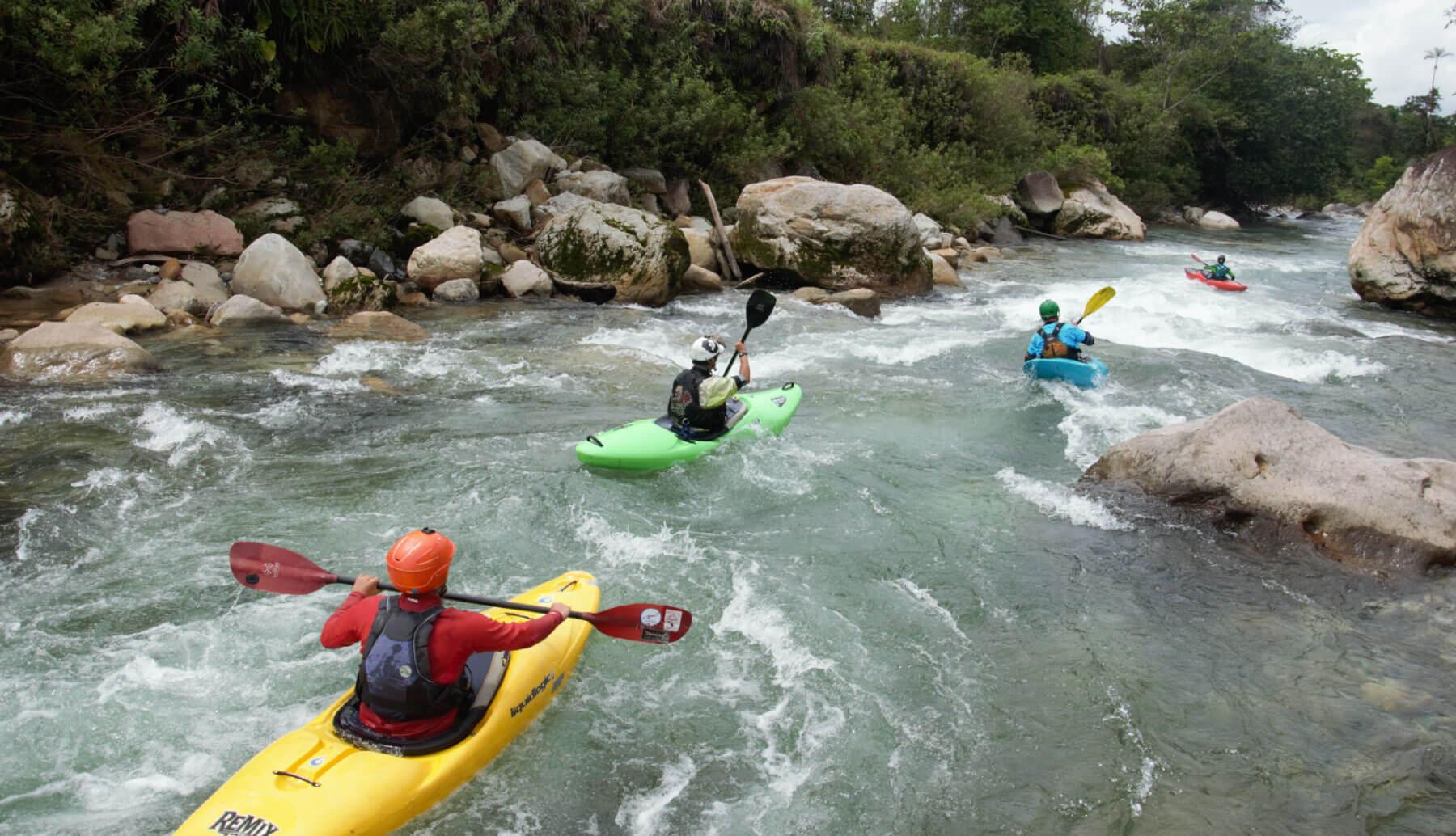 Many kayakers kayaking some rapids