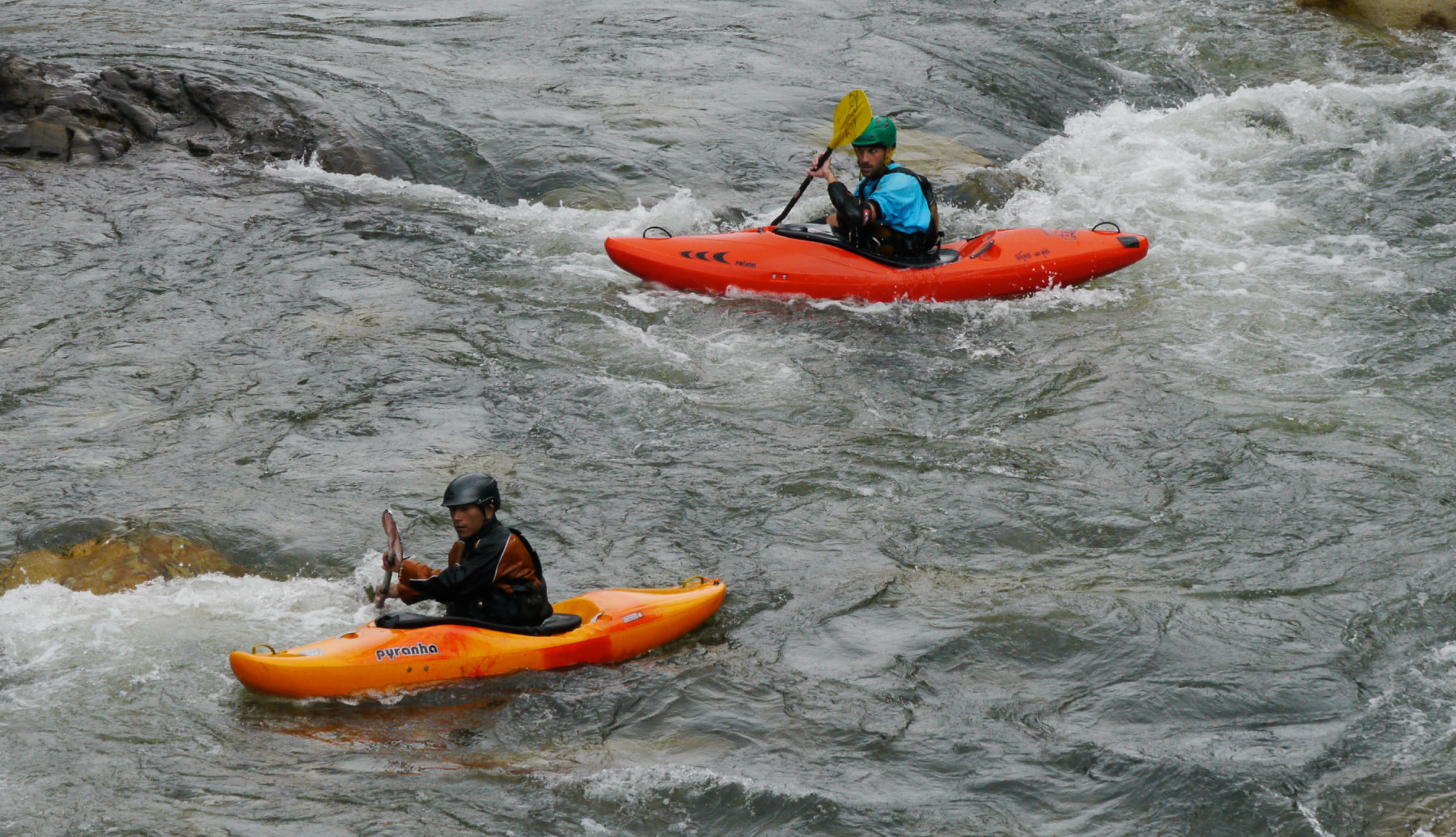Two kayakers in the river