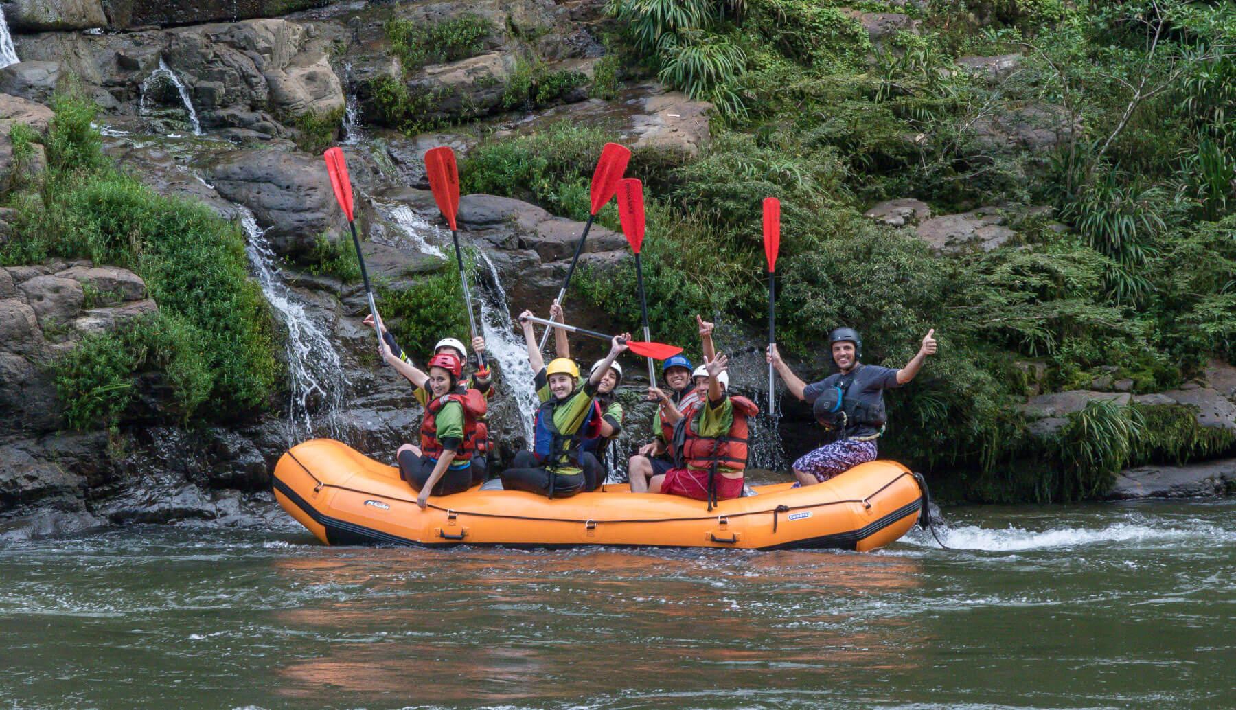 Happy rafters in a rafting boat in Tena, Ecuador.