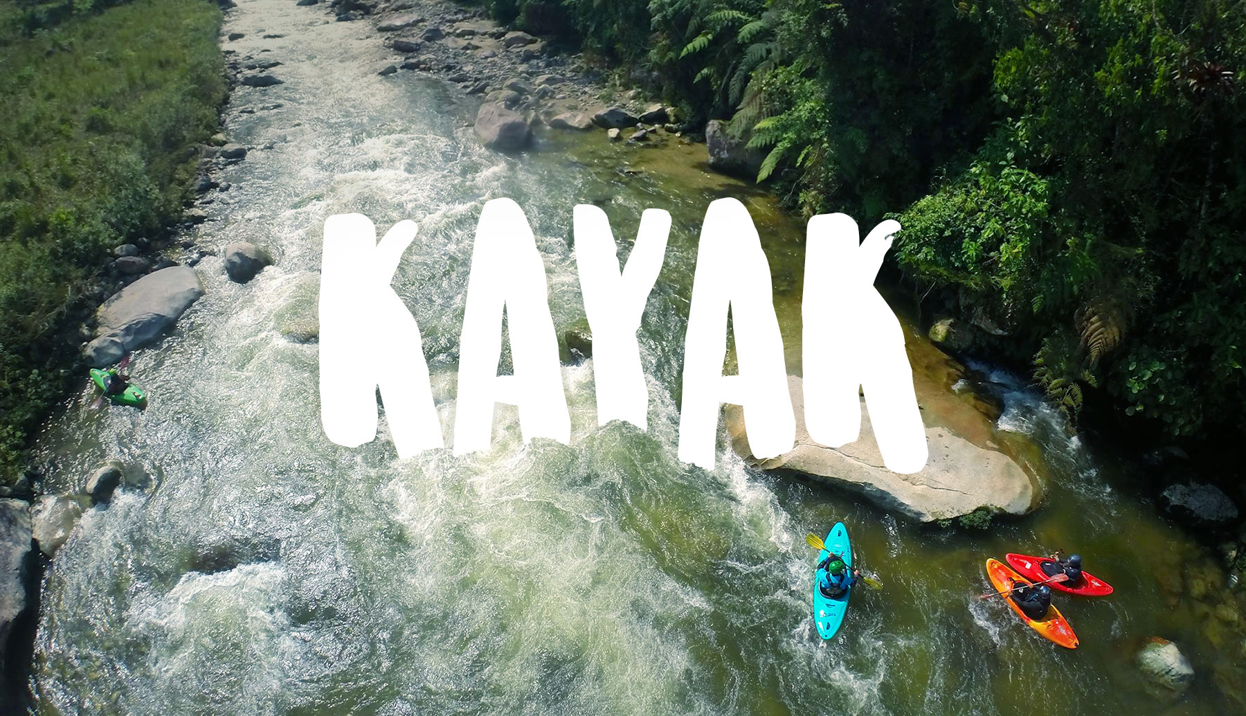 3 Whitewater guides in Kayaks in amazonian river in Ecuador