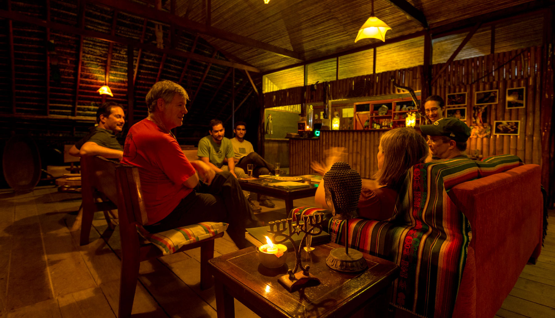 Anaconda Lodge Bar in the night with travellers talking